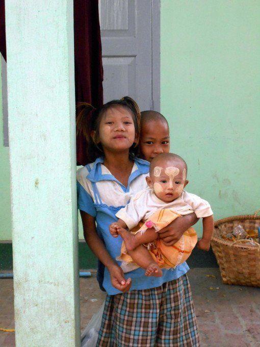 Children wearing Thanaka Paste - InsideBurma Tours
