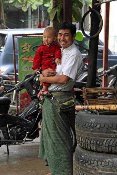 Burmese man sporting a green longyi