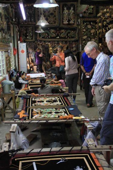 Checking out a kalaga tapestry workshop in Mandalay