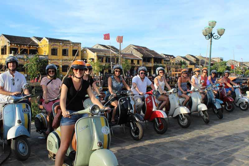 All aboard for the Hoi An Vespa street food tour