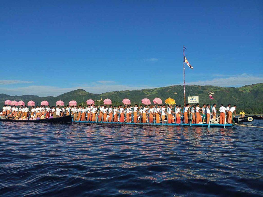 Festival boats glide past
