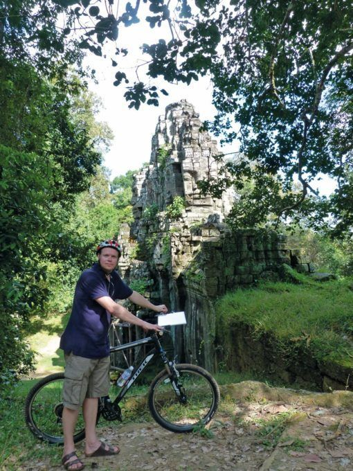 Tom cycling around the temples of Angkor