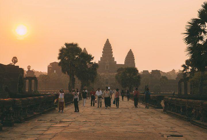People arrive for sunrise over Angkor Wat