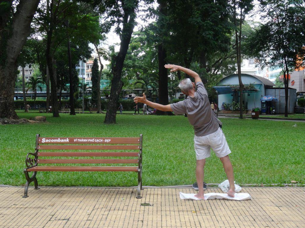 Man does Tai Chi in Tao Dan Park, Vietnam