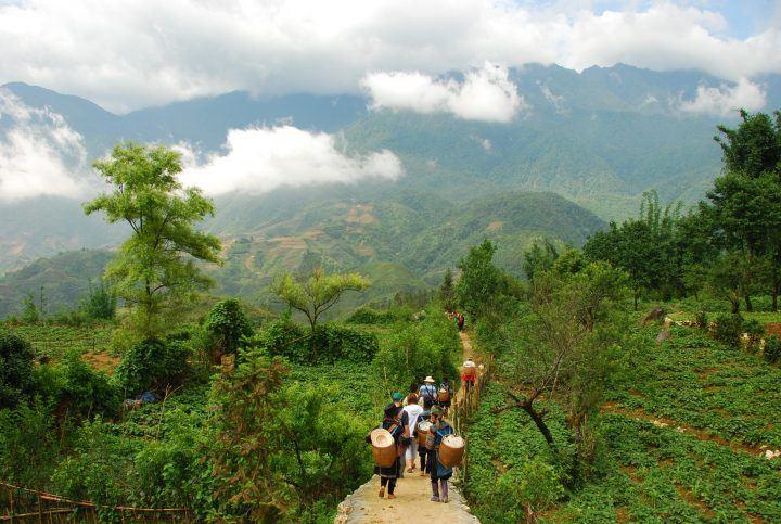 Tourists walking through Sapa, Vietnam