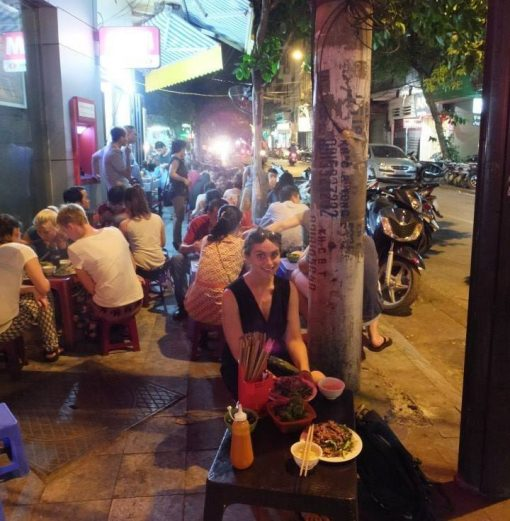 Claire sitting down for pho after 24 hours in Hanoi
