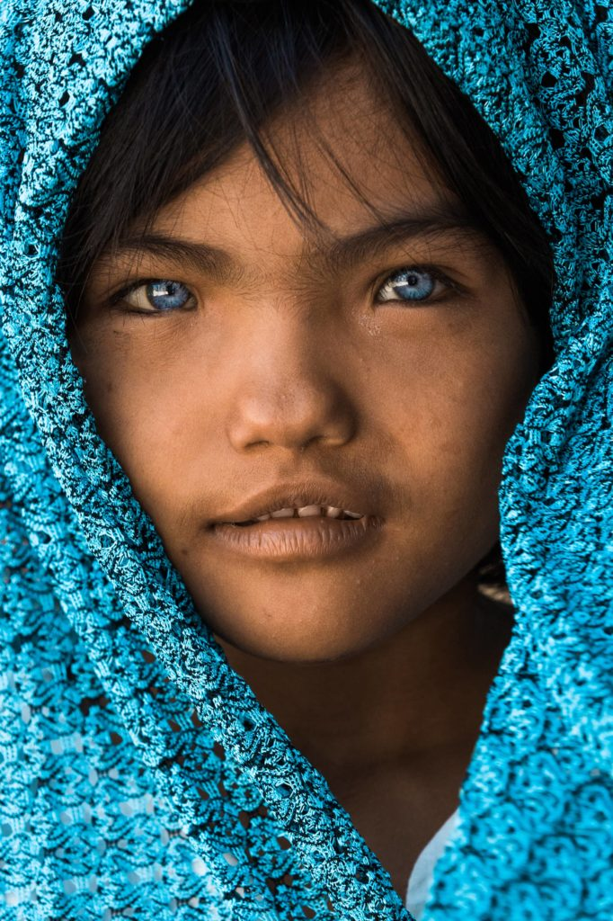 cham vietnam girl with blue eyes headscarf